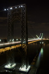 George Washington Bridge At Night (eophir) Tags: fortlee georgewashingtonbridge nocturne nj canon40d bergencounty washingtonheights newyork canoneos nyc steel lights nightscape canon newjersey suspensionbridge bridge 40d verticallandscape palisadesinterstatepark streaks stars clouds reflection reflections bridges eos gwb hudsonriver cars colors nightwalk walkabout nightphotography water river hudson longexposure citylights urbanlights span bestofnjcom bestofnj explore interestingness interesting soe sheildofexcellence light trails lighttrails nybridge njbridge cables architecture seenthroughmyglasseye explored fortleehistoricpark