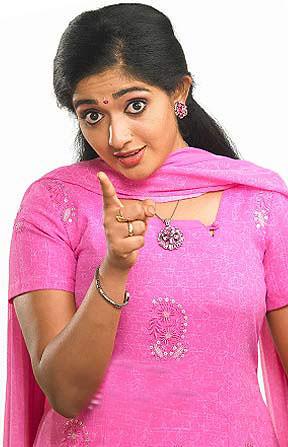 actress Kavya Madhavan in pink dress