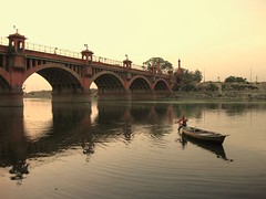 Man on a boat (Shubh M Singh) Tags: bridge portrait india fish river evening boat alone peace dusk solitary lucknow gomti oudh awadh