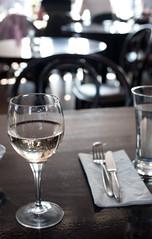 white wine glass in bistro