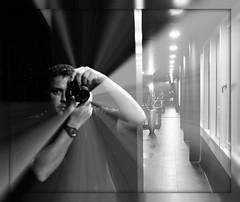 Reflection - Near and Far of Me (Blue Rave) Tags: pictures camera light people blackandwhite bw selfportrait reflection berlin male men guy eye me face lines self germany ego myself deutschland photography lights hotel mirror vanishingpoint eyes nikon europa europe photographer angle framed angles illumination ceiling illuminated dude line frame half mate pathway bloke oneeye selfie halfface maninthemirror 2011 takingaphoto framedportraits d5000 nikond5000 picturesinaframe halffaceportraits