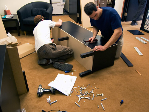 Other People Assembling Office Furniture