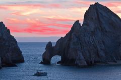 The Arch of Poseidon at Dusk (julesnene) Tags: travel canon mexico eos boat dusk pacificocean bajacalifornia cabosanlucas thearch seaofcortez rockformation rocksculpture 50d southernmosttip julesnene thearchofposeidon photobyjuliasumangil