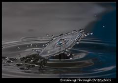 Breaking Through (Drippy2009) Tags: macro reflection wet water closeup speed canon reflections eos droplets drops amazing agua waterdrop aqua eau wasser dof creative drop depthoffield drip dew impact droplet drips ripples splash tap waterdrops acqua liquid ef highspeed collision hispeed wassertropfen chrisc watersplash timing waterdroplet dropplets strobist dropshots canon450d ef180l canonxsi doublesplash dropcollisions