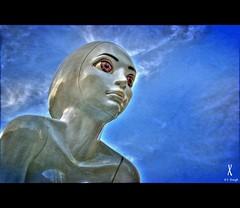I Want To Believe... (e.breizh) Tags: street city blue sky sculpture music art texture statue giant thailand eyes asia emotion bangkok siam et 2009 siamsquare siamparagon sukhumwit ebreizh