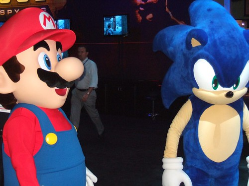 Mario and Sonic hanging out at the Sega Booth