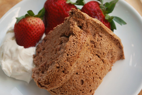 Chocolate Angel Food Cake - light and fluffy chocolate cake. Perfect with summer strawberries and fresh whipped cream!