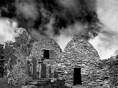 Beehive Huts - Skellig Michael (An diabhal glas) Tags: world ocean life county ireland panorama irish cliff heritage rock vertical stone century photoshop silver island coast michael early site high extreme great rocky lifestyle 9 kerry atlantic christian unesco huts monastery monks software 600 summit pro nik miles celtic walls 12 language fx 230 7th beehive stitched christians michaels steep monastic spartan ascetic conditions founded metre kilometres skellig monasteries remoteness cs5 sceilig mhichl clochans