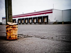 Battered Yellow Drum (Mike Wood Photography) Tags: old yellow docks truck for closed drum sale telephone rusty pole warehouse arr asphalt allrightsreserved loading mikewood mikewoodphotographycom mikewoodphotography