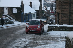 Micra Stuck Bank Road (Matlock-Photo) Tags: road uk winter red england snow ice car canon silver eos nissan crash derbyshire bank east damage slip february icy snowfall micra 2009 slippery 3rd steep matlock midlands wintery slipped prang 400d 020309 treachouous