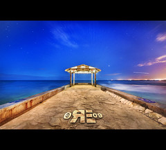 Waikiki Pier (Night Exposures) (Ryan Eng) Tags: ocean longexposure water night stars hawaii pier waikiki oahu citylights frontpage dri sigma1020mm digitalblending explore4 nikond90 ryaneng ryausting