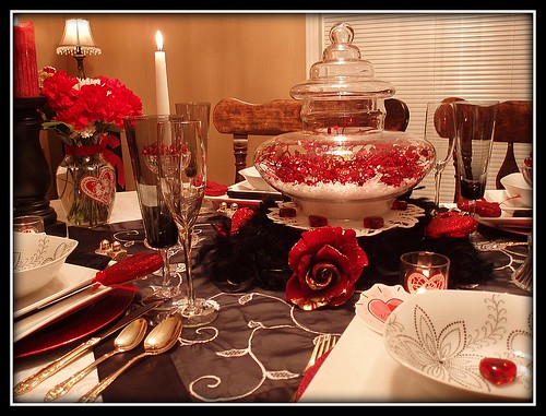 Valentine's Centerpiece. A glass vase is filled with faux snow,