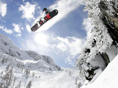 Maciek Swiatkovski cliffjump snowboarding in deep powder. Nassfeld, Austria. 2006 (Rudgr.com) Tags: winter wallpaper snow ski snowboarding high skiing quality widescreen wide screen powder hires wallpapers pow wintersports wallaper wallapers