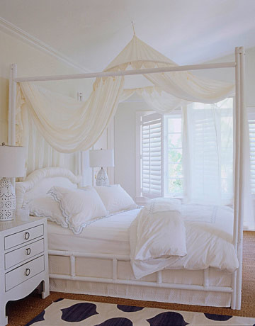 All-white bedroom: Gauzy drapes + bamboo bed + 'Seashell' by Benjamin Moore