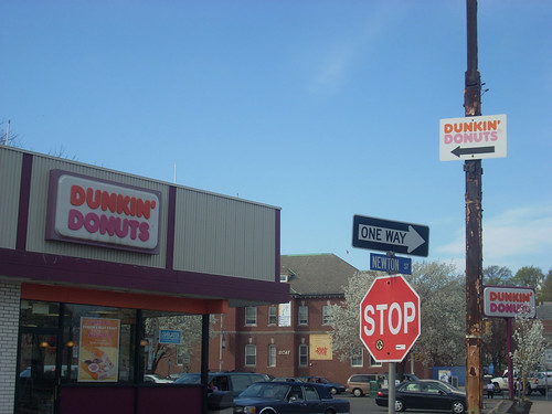 3 signs, 1 donut shop