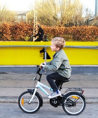 Boy and Dad Cycling to the Bakery