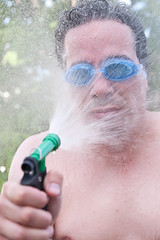 317/365 You want silly? (Paguma / Darren) Tags: portrait selfportrait man silly male me wet water goggles spray hose getty gettyimages fgr 365days tamronspaf1750mmf28xrdiiildasphericalif