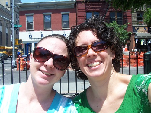 melissa and waldie sitting at father demo square in the west village, nyc