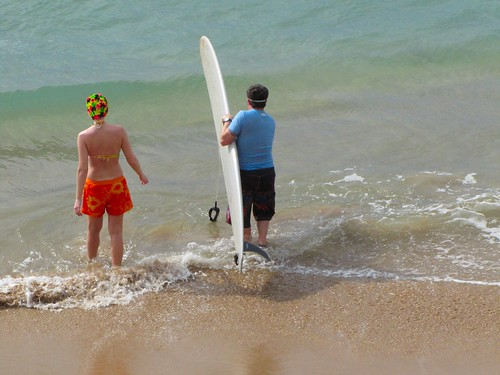the dynamic surfing duo enters the water