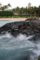 Waves Splashing onto Waikiki Rocks