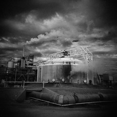 (davidteter) Tags: sky bw film clouds holga tank steam smokestack steamstack holga120n geothermalpowerplant ilfordsfx200 infraredish calenergy stream:timeline=linear film:negative=04 film:sheet=200901211