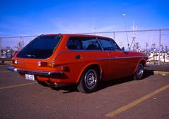 leica217 (aaron piazza) Tags: seattle street leica orange film analog zeiss wagon volvo slide aberdeen positive e100vs m6 p1800es biogon zm 352