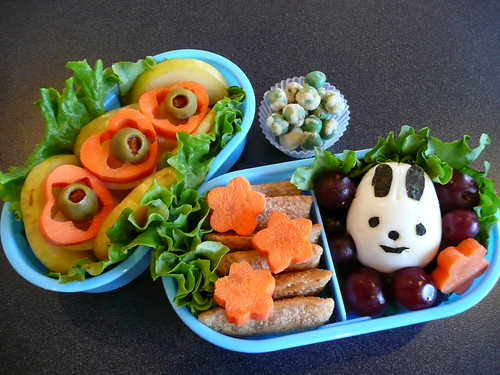Box 1:  Hard boiled egg rabbit, grapes, carrot flowers, mini egg rolls  Box 2:  Green plum slices, cheese under the carrot cutouts, green olives.  Small cup:  Roasted green peas