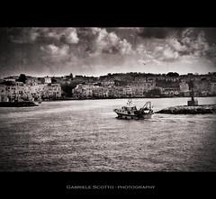 Procida - Marina Grande harbour (gabrielescotto) Tags: old sea blackandwhite bw italy art texture port boat photo fisherman bravo barca italia bn procida biancoenero fisherboat paranza gabrielescotto bratanesque