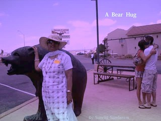 A  BEAR  HUG......?  YES.. But The Bear is Hugging, someone else is..............!