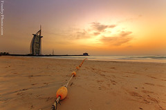Burj alarab Beach - 7 Stars hotel (A.alFoudry) Tags: sunset orange cloud motion building art beach yellow clouds canon ball stars eos hotel sand dubai waves slow gulf dusk mark united 7 wave down line full architect arab shore frame slowshutter shutter 5d 28 guide kuwait fullframe emirate ef kuwaiti burj q8 jumaira alarab abdullah 1635  mark2  1635mm  guideline || f28l 7stars kuw q80 q8city  xnuzha alfoudry  canonef1635mmf28l abdullahalfoudry foudryphotocom unitedarabemirate mark|| 5d|| canoneos5d|| mk|| canoneos5dmark|| canonef1635mmf28l||