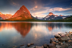 Morning Over Glacier (Michael Bollino) Tags: park morning sky lake snow reflection water clouds sunrise landscape rockies montana rocks glacier national shore glaciernationalpark sweep d300 swiftcurrent swiftcurrentlake grinnelpoint michaelbollino