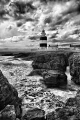 Hook Head B+W (Pockets1) Tags: ireland bw lighthouse seascape jason water canon town rocks surf waves 1785mm wexford 2009 hookhead  the4elements 40d pockets1 jasontown