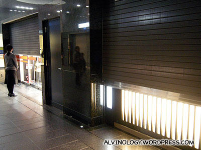 Staff will stand by the window shutters as the shopping malls close for the night