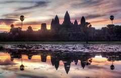The Lotus at Sunrise (Stuck in Customs) Tags: lighting old light wallpaper sky lake building art texture water modern sunrise reflections dark painting fun cool intense ancient perfect cambodia exposure artist mood bright vibrant unique background d2x surreal angkorwat resolution framing portfolio tones magical siemriep