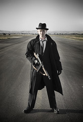 Gangster Desaturated (Trevor James Ingraham) Tags: old school portrait hat gangster gun coat tommy trench era depression desaturated runway 1920 20s characterization strobist