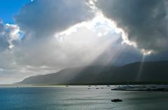 Rays of Light (Jim Boud) Tags: seascape water clouds sailboat photoshop canon landscape intense australia cairns sunrays sunbeams jimboud jrbxom jamesboud jamesboudphotoart