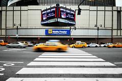 Speeding by Madison Square Garden (Paul Flynn (Toronto)) Tags: newyorkcity usa newyork motion hockey yellow manhattan cab taxi united arena states crosswalk madisonsquaregarden rangers statium