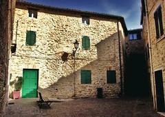 Staffolo (Italy) Piazzetta con panchina e porta verde (pietrocerioni) Tags: yourcountry