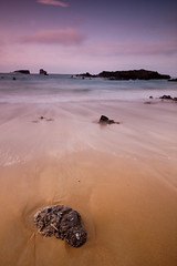 Atardecer en Playa de Ris (jsmoral) Tags: sea espaa paisajes luz landscape geotagged atardecer mar agua rocks playa arena es 1224mm rocas cantabria piedras noja temas canoneos40d geo:lat=43491895 geo:lon=3533408