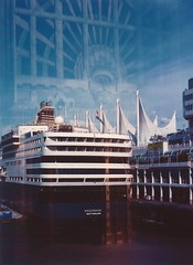 set to sail (SqueakyMarmot) Tags: urban vancouver darkroom mediumformat downtown waterfront doubleexposure kodakportra400vc scanned cruiseship canadaplace neighbourhood marinebuilding burrardstreet eastbuilding 120rollfilm colourprint vancouverconventioncentre zeissikonnettar51716 colournegativefilm may2009 novaranastigmat75mmf63 dryprint