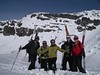 A group of skiers takes a moment for a picture at the top of Chapelco