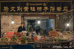 Muslim Street, Xi'an China (DocTony Photography) Tags: china street travel man lightbulb stand nikon asia market chinese stall tokina xian sell d90 doctony 1116f28