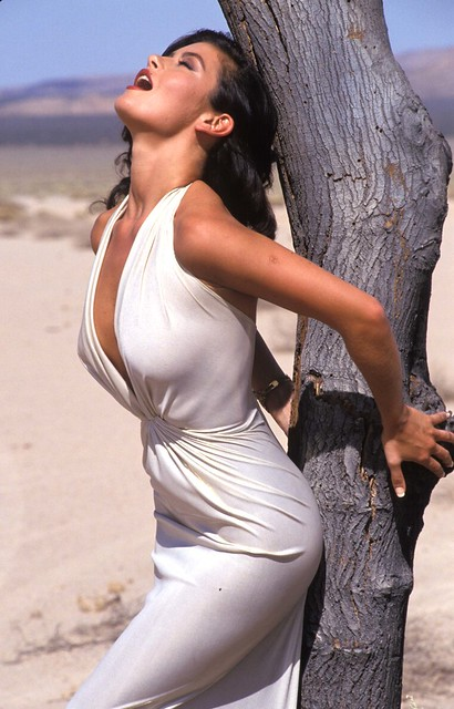 CATHERINE ZETA JONES leaning on a tree
