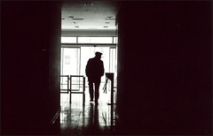 blackout - tbilisi (chirgy) Tags: light man silhouette contrast georgia walking office scan neopan analogue exit turnstile chiaroscuro tbilisi powercut elvishasleftthebuilding 400cn 00400 v500 flathat   autaut pentaxespio120mi