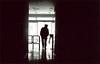 blackout - tbilisi (chirgy) Tags: light man silhouette contrast georgia walking office scan neopan analogue exit turnstile chiaroscuro tbilisi powercut elvishasleftthebuilding 400cn 00400 v500 flathat თბილისი საქართველო autaut pentaxespio120mi