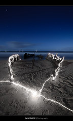 Many Moons Ago (182 seconds) ([ Kane ]) Tags: longexposure beach water night canon star ss australia brisbane sparklers explore qld queensland kane caloundra dicky gledhill 400d kanegledhill kanegledhillphotography