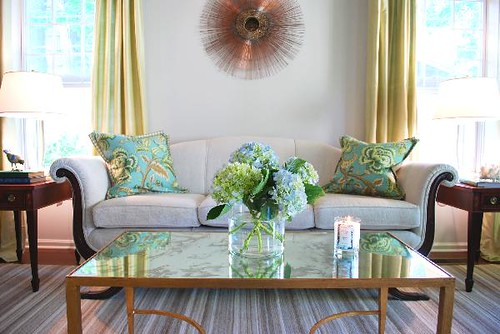 [Real Homes] Neutral paint color: Stylish living room + symmetry + colorful pillows: Benjamin Moore 'Pale Oak' by xJavierx.