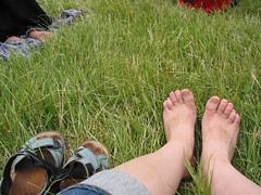 Feet in wild grasses at UBC Farm