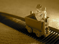 Combing The Couch For Treasure (JD Hancock) Tags: people favorite woman man macro scale closeup sepia fun miniature photo image little small perspective picture explore cc tiny hero figure ho monday char comb indianajones minecar hoscale thesecretlifeoftoys nogeo littledudes inkitchen 7daysofshooting monomonday fauxride jdhancock week47groomingproducts