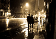 """Rained down couple"" (Sion Fullana) Tags: newyork blur rain sepia night lumix lluvia creative blurred nightshots umbrellas raining pouring allrightsreserved rainynight creativeshots panasonicdmcfz50 sionfullana nightinnewyork coupleintherain sionfullanasphotography sionfullana newyorkintherainatnight nightofrainseries"